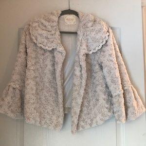 Faux fur jacket with macrame finishing